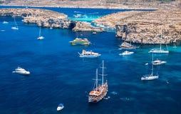 Blue lagoon at Comino - Malta. COMINO, MALTA - JULY 16: Ship at Blue lagoon at island Comino - Malta on July 16, 2015 in Comino Stock Images