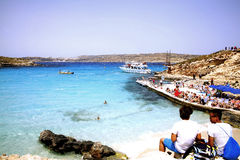 The Blue Lagoon, Comino, Malta. The light blue sea of the Blue Lagoon, Comino, Malta Royalty Free Stock Images