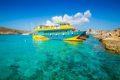 BLUE LAGOON, COMINO, MALTA - OCTOBER 17, 2016: Visitors and tourists arriving on a boat. To enjoy the clear turquoise water and the other wonders of the Blue Stock Image