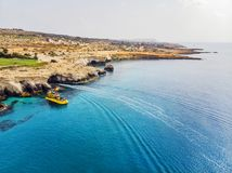 The Blue Lagoon on Cyprus Island tropical sea beach Cavo Greco in morning. Natural stone rock love bridge. The Blue Lagoon on Cyprus Island tropical sea beach stock photography