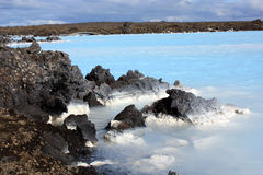 Blue lagoon in iceland. The bright blue waters of the blue lagoon in iceland famous for its thermal spa Stock Image