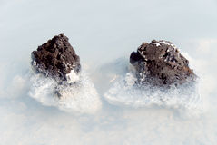 Blue Lagoon Iceland. Deposits and lava rocks with lichens in the blue lagoon iceland Stock Images