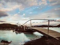 Blue lagoon, Iceland. Beautiful blue lagoon with a wooden bridge - Iceland Stock Photos