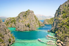 Blue lagoon with longtail boats by Karangan Lake in Coron Palawan - Beautiful tropical destination in Philippines - Travel. Concept to nature wonders around the royalty free stock photography