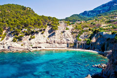 Blue lagoon in Mallorca island. Beautiful lagoon Cala Banyalbufar in Mallorca island, Spain Stock Photography