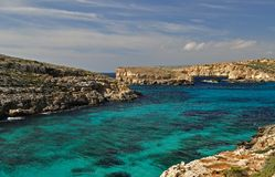 Blue lagoon - Malta. Blue Lagoon in island of Comino - Gozo - Malta Mediterranean sea, crystal water and deep blue Stock Image
