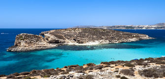 Blue Lagoon - Malta. The Blue Lagoon is a picturesque bay in Malta, between island of Comino and adjacent islet of Cominotto Royalty Free Stock Photography
