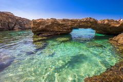 Blue Lagoon, Malta - The arch of the Blue Lagoon on the island of Comino. On a bright sunny summer day with blue sky Stock Photography