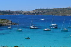 The Blue Lagoon in Malta. Beautiful View and Crystal Clear Water and floating boats in the Blue Lagoon in Comino North of Malta royalty free stock image