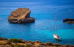 Blue Lagoon, Malta - Sailing boat at the famous Blue Lagoon at the Island of Comino on bright sunny summer day. With crystal clear azure sea water Royalty Free Stock Photography
