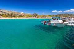 Blue lagoon of Marathi bay with fishing boats on Crete stock images