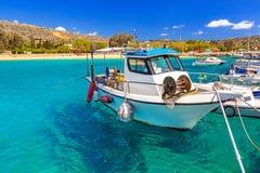 Blue lagoon of Marathi bay with fishing boats. On Crete, Greece Stock Image