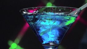Blue lagoon over ice cubes stock footage