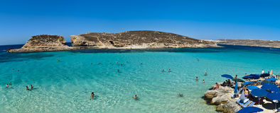 Blue Lagoon panorama. View over the Blue Lagoon in Malta, Comino Island. With its light blue crystal clear waters and white sandy sea bottom, the Blue Lagoon is Royalty Free Stock Image
