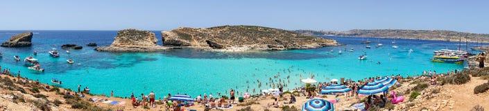 The Blue Lagoon Panorama in Malta. 13 July 2018 - Comino Island, Malta. Panorama of the Blue Lagoon, exotic Meditteranean Sea coast in Comino island located in Stock Photography