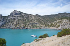Blue lagoon. Rocky bank, blue sea and yacht Stock Photography
