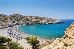 Blue lagoon with sandy beach of Matala town on Crete island, Greece Stock Photos