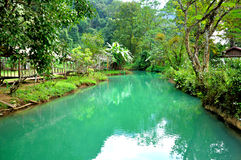 Blue lagoon in Vang Vieng, Laos. Blue lagoon is wonderful clear stream outside the Tham Phu Kham cave Royalty Free Stock Images