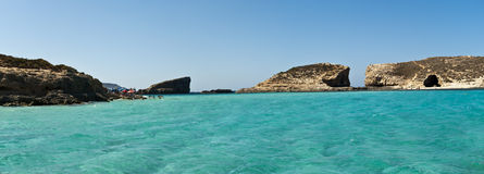 Blue Lagoon water. In Malta, between Comino and adjacent islet of Cominotto lie the transparent, cyan waters of the Blue Lagoon Stock Photos