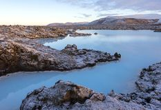 Blue lagoon waters at winter in Iceland. Volcanic formations filled with white-blue warm water royalty free stock image