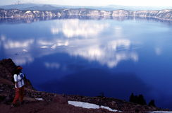 Blue Lake. A woman pauses to take in the breath-taking view of Crater Lake, Crater Lake National Park, Oregon, USA Royalty Free Stock Photography