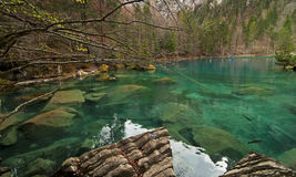 Blue lake. ( Blausee) in the Swiss alpine range Stock Image
