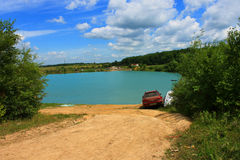 The Blue lake. The Photography in the centre which lake, clean blue sky, wood, herb Royalty Free Stock Photo