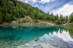 Blue lake arolla, val d`herens, la gouille, Switzerland Royalty Free Stock Photography