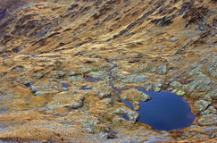 The blue lake as seen from the mountain top Royalty Free Stock Photo