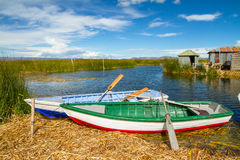 Blue lake with boats at the shore, titicaca lake Royalty Free Stock Image