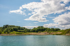 Blue lake, bright sunny day Royalty Free Stock Image