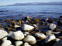 Blue lake with coast of stones. Blue lake with rocky coastline Stock Photography