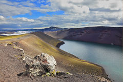 The blue lake in crater of volcano Stock Photography