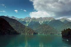 Blue lake deep in the mountains stock images