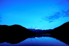 Blue lake in evening light Royalty Free Stock Images