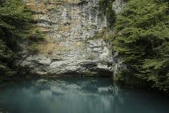 Blue lake at the foot of the mountain, Caucasus. Beautiful panorama, natural landscape. Blue lake at the foot of the mountain, Caucasus. Stone rock reflecting Stock Photos