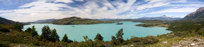 Blue lake among the green hills or Torres del Pain Stock Image