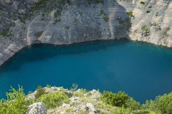 Beautiful nature and landscape photo of Blue Lake Imotski Croatia. Blue Lake Imotski Croatia, Beautiful nature and landscape photo of very big, deep sinkhole in stock images
