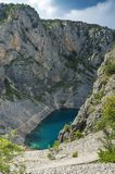 Beautiful nature and landscape photo of Blue Lake Imotski Croatia. Blue Lake Imotski Croatia, Beautiful nature and landscape photo of very big, deep sinkhole in stock photos