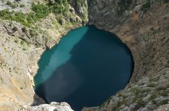 Beautiful nature and landscape photo of Red Lake Imotski Croatia. Blue Lake Imotski Croatia, Beautiful nature and landscape photo of very big, deep sinkhole in stock image