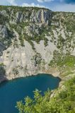 Beautiful nature and landscape photo of Blue Lake Imotski Croatia. Blue Lake Imotski Croatia, Beautiful nature and landscape photo of very big, deep sinkhole in stock photography