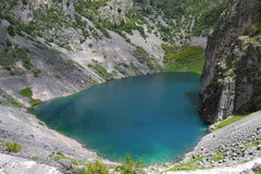 The Blue Lake, Imotski, Croatia. While walking down the path to the Blue Lake in Imotski, Croatia, you can get this view of the amazing turquoise waters of the Stock Image