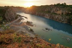 Blue lake on a manmade canyon and sunset Royalty Free Stock Image