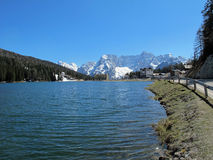 Blue Lake Misurina with dolomiti mountains in the background Royalty Free Stock Photography