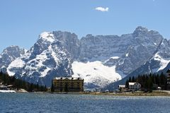 Blue Lake Misurina with dolomiti mountains in the background Royalty Free Stock Photo