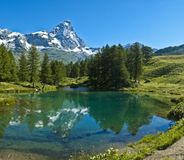Blue lake and Mount Cervino. The Matterhorn reflected in the clear waters of blue lake, Valtournenche - Aosta Valley royalty free stock image
