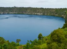 The Blue Lake in Mount Gambier  is an explosive volcanic crater. The colour of the blue lake in Mouint Gambier changes dramatically from grey to vivid blue over Royalty Free Stock Images