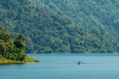 A blue lake. Mountain green forest and boat Royalty Free Stock Images