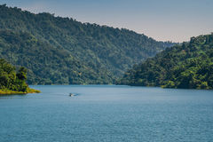 A blue lake. Mountain green forest and boat Stock Images