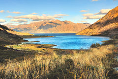Blue Lake with Mountain Range and Blue Sky in South Island, New Stock Photos